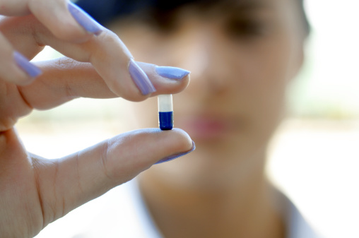 Woman holding nootropic supplement
